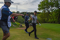 Kevin Na (USA) hands his driver to his caddie as he heads down 3 during day 4 of the WGC Dell Match Play, at the Austin Country Club, Austin, Texas, USA. 3/30/2019.<br /> Picture: Golffile | Ken Murray<br /> <br /> <br /> All photo usage must carry mandatory copyright credit (© Golffile | Ken Murray)
