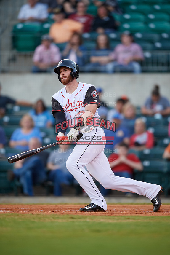 Arkansas Travelers first baseman Kyle Petty (27) follows through on a swing during a game against the Midland RockHounds on May 25, 2017 at Dickey-Stephens Park in Little Rock, Arkansas.  Midland defeated Arkansas 8-1.  (Mike Janes/Four Seam Images)
