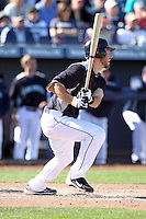 Dustin Ackley #13 of the Seattle Mariners bats in a spring training game against the San Diego Padres at Peoria Stadium on February 27, 2011  in Peoria, Arizona. .Photo by:  Bill Mitchell/Four Seam Images.
