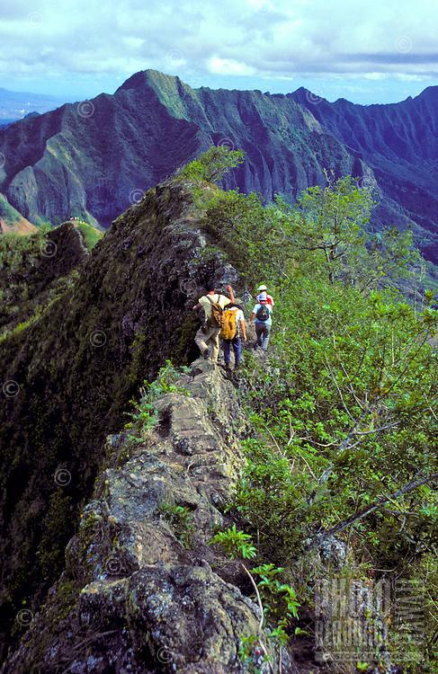 Hikers on the ridge of Kolekole pass, Leeward Oahu
