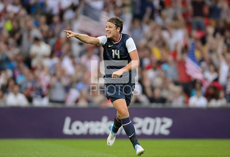 London, England - Thursday, August 9, 2012: The USA defeated Japan 2-1 to win the London 2012 Olympic gold medal at Wembley Stadium. Abby Wambach celebrates Carli Lloyd's first goal. .