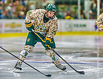 25 November 2014: University of Vermont Catamount Forward Brendan Bradley, a Sophomore from Warminster, PA, in action against the University of Massachusetts Minutemen at Gutterson Fieldhouse in Burlington, Vermont. The Cats defeated the Minutemen 3-1 to sweep the 2-game, home-and-away Hockey East Series. The 12th ranked Catamounts wore their camouflage uniforms for the evening to honor the US military. Mandatory Credit: Ed Wolfstein Photo *** RAW (NEF) Image File Available ***