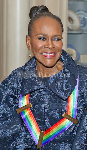 Actress and Broadway star Cicely Tyson, one of the five recipients of the 38th Annual Kennedy Center Honors, smiles after posing as part of a group photo following a dinner hosted by United States Secretary of State John F. Kerry in their honor at the U.S. Department of State in Washington, D.C. on Saturday, December 5, 2015.  The 2015 honorees are: singer-songwriter Carole King, filmmaker George Lucas, actress and singer Rita Moreno, conductor Seiji Ozawa, and actress and Broadway star Cicely Tyson.<br /> Credit: Ron Sachs / Pool via CNP/MediaPunch