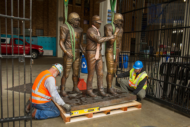 Oct. 17, 2014; The Lou Holtz statue is removed for  the Crossroads construction project at Notre Dame Stadium. (Photo by Barbara Johnston/University of Notre Dame)