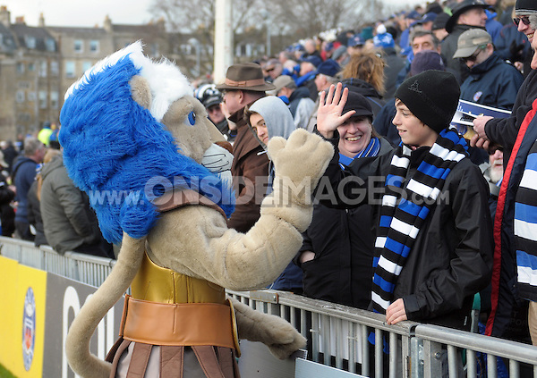 Bath Rugby mascot Maximus high-fives a member of the crowd at half-time. Aviva Premiership match, between Bath Rugby and London Wasps on February 22, 2014 at the Recreation Ground in Bath, England. Photo by: Patrick Khachfe / Onside Images
