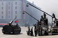 In this photo taken Sunday, April 15, 2012, a North Korean artillery drives past North Korean journalists during mass military parade in Pyongyang's Kim Il Sung Square to celebrate 100 years since the birth of North Korean founder, Kim Il Sung. Inside DPRK""