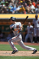 OAKLAND, CA - JULY 22:  Kelby Tomlinson #37 of the San Francisco Giants bats against the Oakland Athletics during the game at the Oakland Coliseum on Sunday, July 22, 2018 in Oakland, California. (Photo by Brad Mangin)