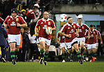 AUSTRALIA, Canberra : Captain Rory Best, centre, of the British and Irish Lions runs onto the field during the tour match in Canberra on June 18, 2013. The Brumbies won 14-12.  IMAGE STRICTLY RESTRICTED TO EDITORIAL USE - STRICTLY NO COMMERCIAL USE AFP PHOTO / Mark GRAHAM