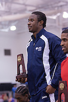 Ravel Grey on the award stand with his 3rd place trophy in the 60 meters.