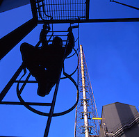 Climbing safety ladder in industrial area.