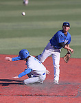 Wildcats' David Modler turns a double play against Salt Lake Community College's Skyler Mahoney during a college baseball game at Western Nevada College in Carson City, Nev., on Thursday, March 5, 2015. <br /> Photo by Cathleen Allison/Nevada Photo Source