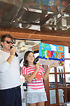 The Young and the Restless Jeff Branson (AMC) with Morgan and their painting at SoapFest's Celebrity Weekend - Cruisin' and Schmoozin' on the Marco Island Princess - mix and mingle and watching dolphins - autographs, photos, live auction raising money for kids on November 11, 2012 Marco Island, Florida. (Photo by Sue Coflin/Max Photos)