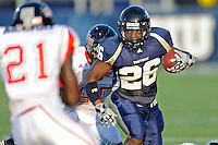 27 November 2010:  FIU running back Darrian Mallary (26) carries the ball in the second quarter as the FIU Golden Panthers defeated the Arkansas State Red Wolves, 31-24, at FIU Stadium in Miami, Florida.