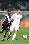 12 JUN 2010: Jamie Carragher (ENG) (18) and Robbie Findley (USA) (20). The England National Team played the United States National Team to a 1-1 tie at Royal Bafokeng Stadium in Rustenburg, South Africa in a 2010 FIFA World Cup Group C match.