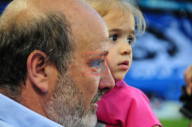 Dani Jarque's Daughter and father going to the center to led the daughter kick off -  Dani Jarque's tribute game (21) Organized by Andres Iniesta and RCD espanyol