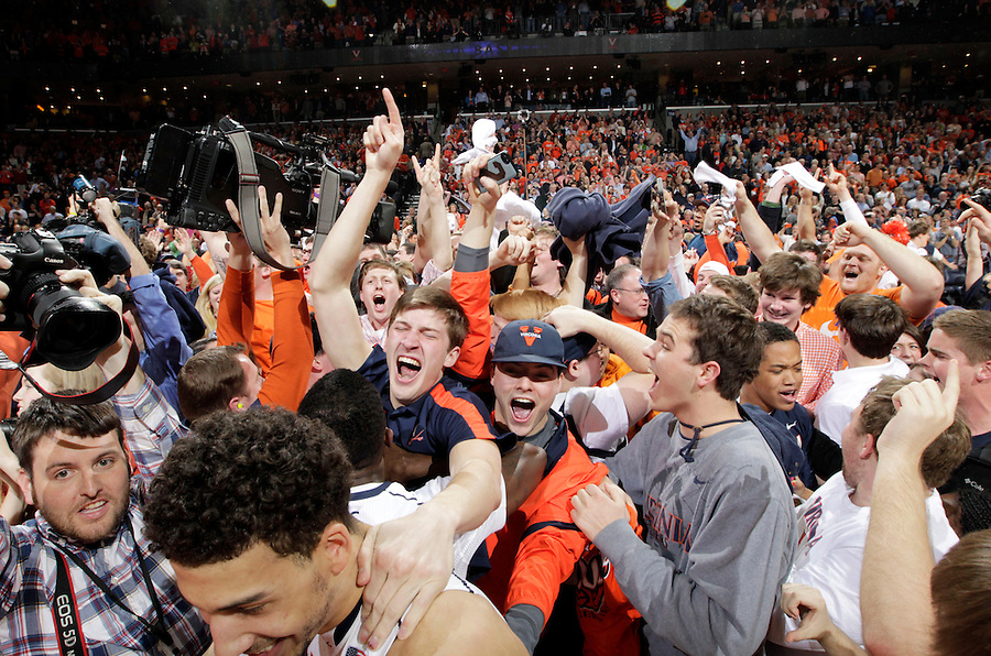 Virginia fans rush the court after Virginia defeated Syracuse 75-56 in an NCAA basketball game Saturday March 1, 2014 in Charlottesville, VA.