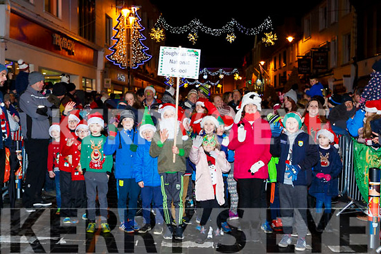 Loughquittane NS pupils marching in the Kiilarney Christmas parade through the packed streets  on Saturday night