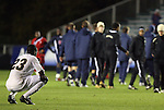 13 November 2009: Wake Forest's Ike Opara (23) sinks to his knees after the loss. The University of Virginia Cavaliers defeated the Wake Forest University Demon Deacons 4-3 on penalty kicks after the game ended in a 0-0 tie after overtime at WakeMed Stadium in Cary, North Carolina in an Atlantic Coast Conference Men's Soccer Tournament Semifinal game.