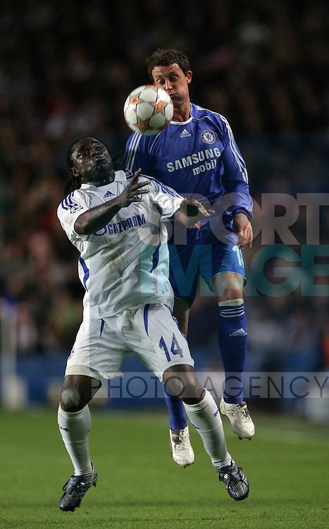 Chelsea's Wayne Bride tussles with Shalke's Gerald Asamoah