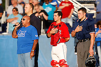 August 5, 2009:  National Anthem during ARC night before a game at Dwyer Stadium in Batavia, NY.  Umpire Aaron Larson, Catcher Alan Ahmady, Umpire Tim Rosso.  The Muckdogs are the Short-Season Class-A affiliate of the St. Louis Cardinals.  Photo By Mike Janes/Four Seam Images