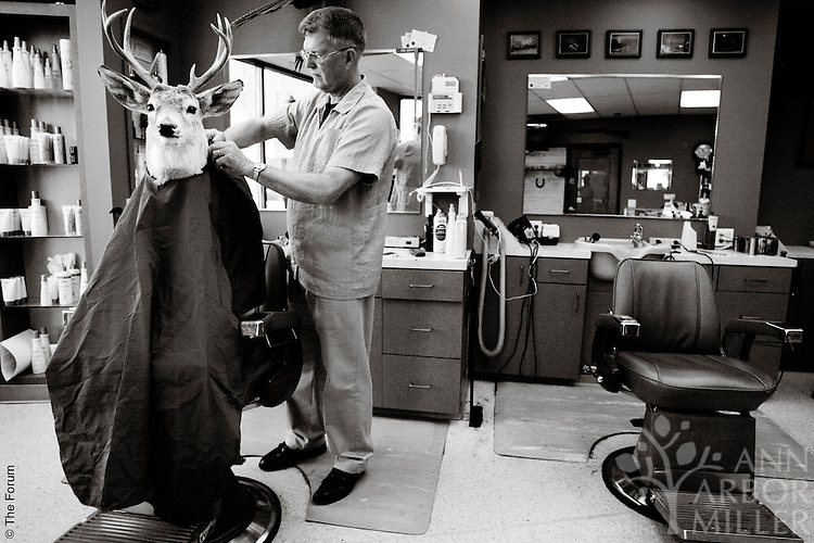 The scene inside Graver Barbers in downtown Fargo, N.D., the day before deer hunting season opened in November 2004.