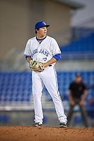 Dunedin Blue Jays relief pitcher William Ouellette (15) gets ready to deliver a pitch during a game against the Fort Myers Miracle on April 17, 2018 at Dunedin Stadium in Dunedin, Florida.  Dunedin defeated Fort Myers 5-2.  (Mike Janes/Four Seam Images)