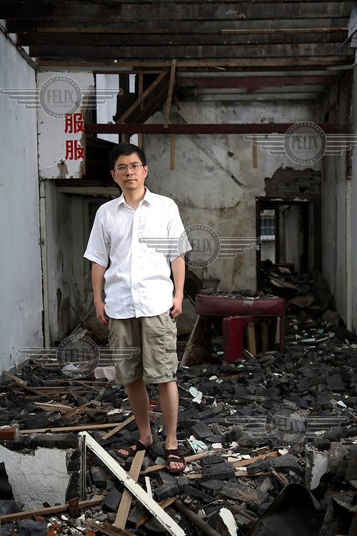 "Shu Haolun, Shanghai filmmaker who made ""Nostalgia"", a film about the disappearance of his old Shanghai neighbourhood, photographed here on what is left of that area in Shanghai."