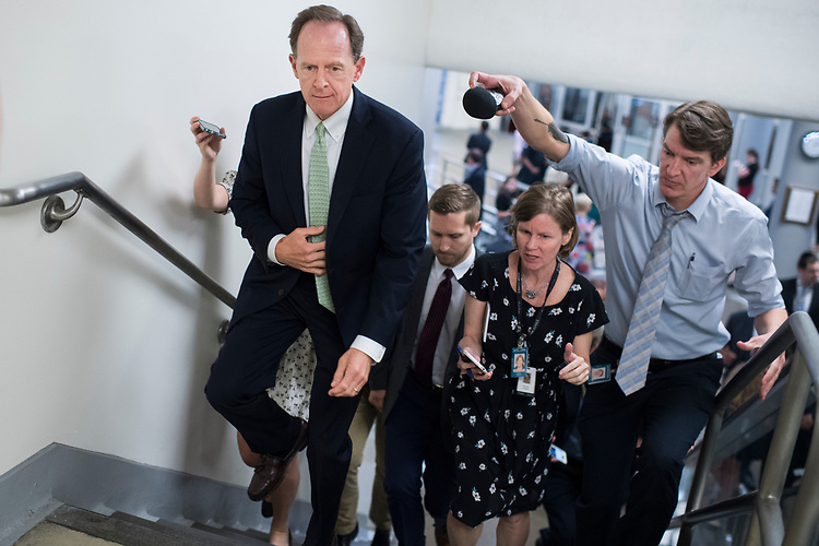 UNITED STATES - JULY 24: Sen. Pat Toomey, R-Pa., talks with reporters in the Capitol's Senate subway before the Senate Policy luncheons on July 24, 2018. (Photo By Tom Williams/CQ Roll Call)