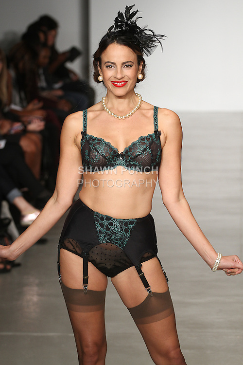 Model walks runway in lingerie from the Secrets In Lace collection, with Dita Von Tesse Stockings, during LingerieFW Spring Summer 2015.