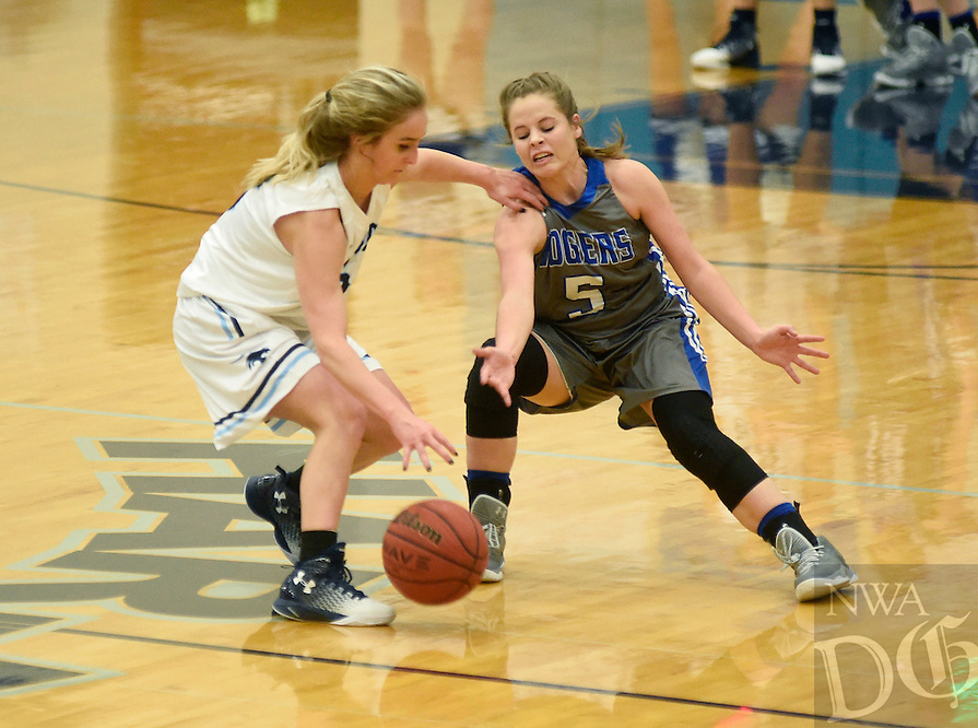 NWA Democrat-Gazette/MICHAEL WOODS @NWAMICHAELW<br /> Emma Wisdom from Rogers (5) puts the pressure on Har-Ber's Annabel Weber (3) as she tries to bring the ball up court Friday, February 3, 2017 during their game in Springdale
