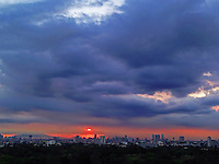 Manila Skyline at sunset and approaching storm, Philippines