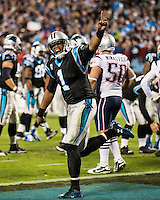The Carolina Panthers play the New England Patriots at Bank of America Stadium in Charlotte North Carolina on Monday Night Football.  The Panthers defeated the Patriots 24-20.  Carolina Panthers quarterback Cam Newton (1) celebrates a Panthers touchdown