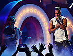 MIAMI, FL - JULY 17: Romeo Santos perform onstage during the Premios Juventud 2014 Awards at BankUnited Center on July 17, 2014 in Miami, Florida. (Photo by Johnny Louis/jlnphotography.com)
