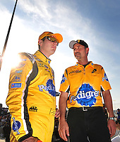 May 2, 2008; Richmond, VA, USA; NASCAR Sprint Cup Series driver Kyle Busch (left) with crew chief Steve Addington during qualifying for the Dan Lowry 400 at the Richmond International Raceway. Mandatory Credit: Mark J. Rebilas-US PRESSWIRE