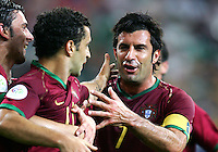 Luis Figo (7) congratulates teammate Simao Sabrosa (11) of Portugal on his goal. Portugal defeated Mexico 2-1 in their FIFA World Cup Group D match at FIFA World Cup Stadium, Gelsenkirchen, Germany, June 21, 2006.