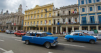 Havana, Cuba - A taxi drives on Paseo de Martí near Parque Central (Central Park). Classic American cars from the 1950s, imported before the U.S. embargo, are commonly used as taxis in Havana.