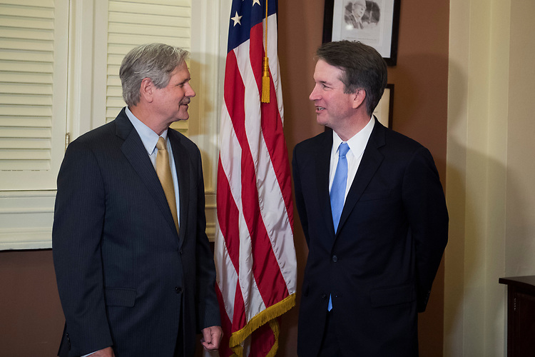 UNITED STATES - AUGUST 01: Supreme Court nominee Brett Kavanaugh, right, and Sen. John Hoeven, R-N.D., conduct a photo-op in Capitol before a meeting on August 1, 2018. (Photo By Tom Williams/CQ Roll Call)