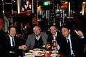 TOKYO - DEC. 9:Four fab customers at The Cavern Club, Roppongi, enjoy a drink underneath a photo of The Fab Four. (Photo by Alfie Goodrich/Nippon News)