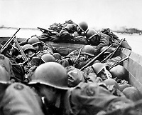 &quot;I drew an assault boat to cross in - just my luck.  We all tried to crawl under each other because the lead was flying around like hail.&quot;  Crossing the Rhine under enemy fire at St. Goar, March 1945.  Army. (OWI)<br /> Exact Date Shot Unknown<br /> NARA FILE #:  208-YE-132<br /> WAR &amp; CONFLICT BOOK #:  1086