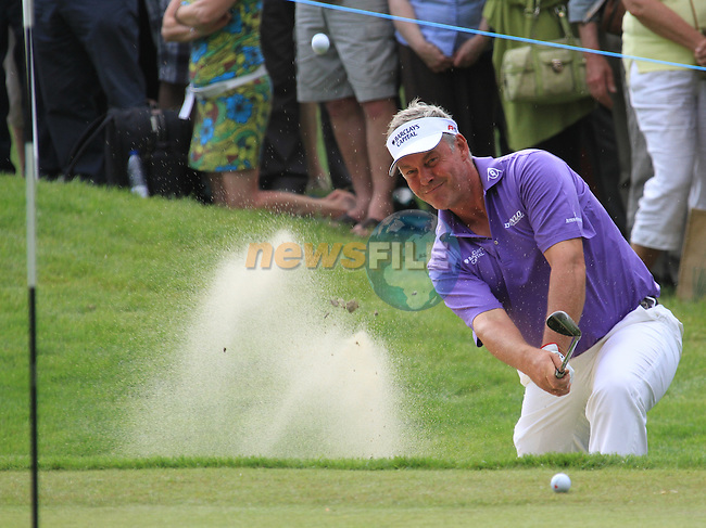 Darren clarke chipping from the bunker ont he 16th.during round two of the BMW PGA championship 2010 at Wentworth golf club, Surrey England..Picture Fran Caffrey/Newsfile.ie