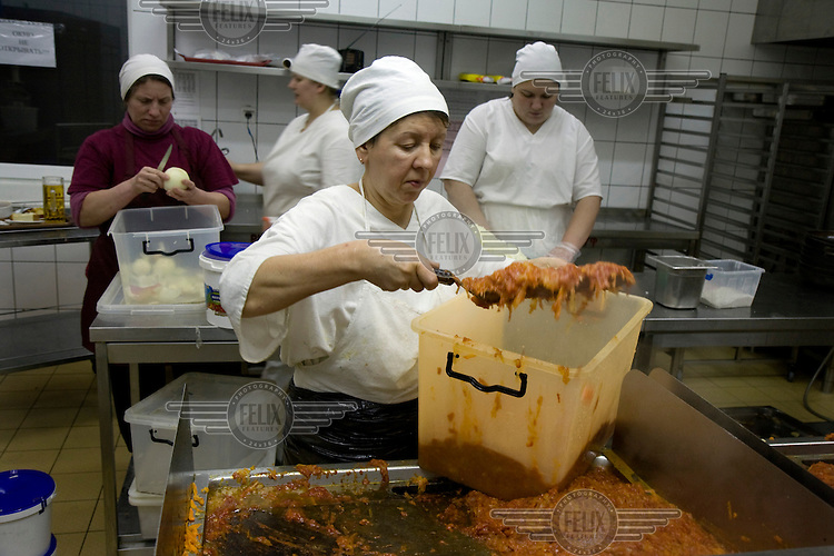 Cooks prepare borshch at the Puzata Khata fastfood restaurant in Kyiv. Borshch is a traditional Ukrainian beetroot soup that is popular throughout Central and Eastern Europe.