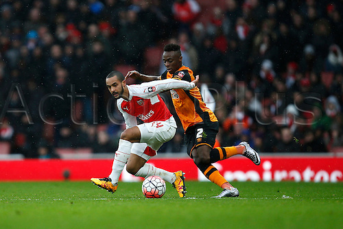 20.02.2016. The Emirates, London, England. Emirates FA Cup 5th Round. Arsenal versus Hull City. Theo Walcott of Arsenal rides the challenge of Moses Odubajo of Hull.  The game finished in a tight 0-0 draw