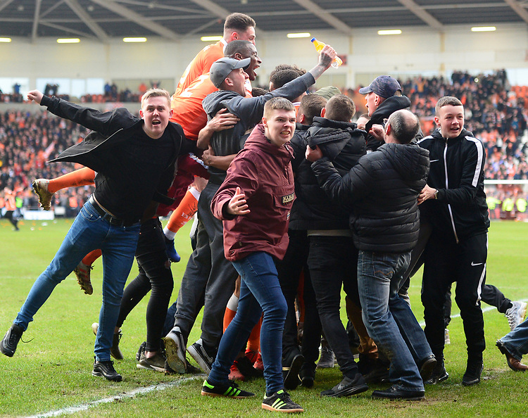 Blackpool players are mobbed by fans afterTaylor Moore of Southend United scored an own goal<br /> <br /> Photographer Richard Martin-Roberts/CameraSport<br /> <br /> The EFL Sky Bet League One - Blackpool v Southend United - Saturday 9th March 2019 - Bloomfield Road - Blackpool<br /> <br /> World Copyright © 2019 CameraSport. All rights reserved. 43 Linden Ave. Countesthorpe. Leicester. England. LE8 5PG - Tel: +44 (0) 116 277 4147 - admin@camerasport.com - www.camerasport.com