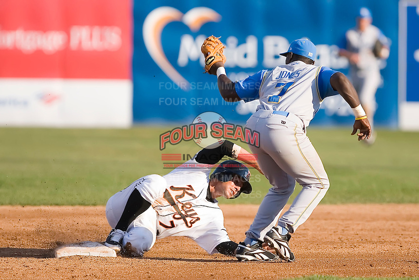 Todd Davison (7) of the Frederick Keys avoids the tag of second baseman Travis Jones (7) of the Myrtle Beach Pelicans at Harry Grove Stadium in Frederick, MD, Monday July 14, 2008. (Photo by Brian Westerholt / Four Seam Images)