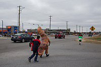 NWA Democrat-Gazette/CHARLIE KAIJO Anime Festival attendees cross the street on Sunday, November 12, 2017 at Four Points Sheraton Hotel in Bentonville. The Hotel hosted the Arkansas Anime Festival - Northwest Arkanas Edition 2017. Fans enjoyed product displays, gaming parties and artist Q&As