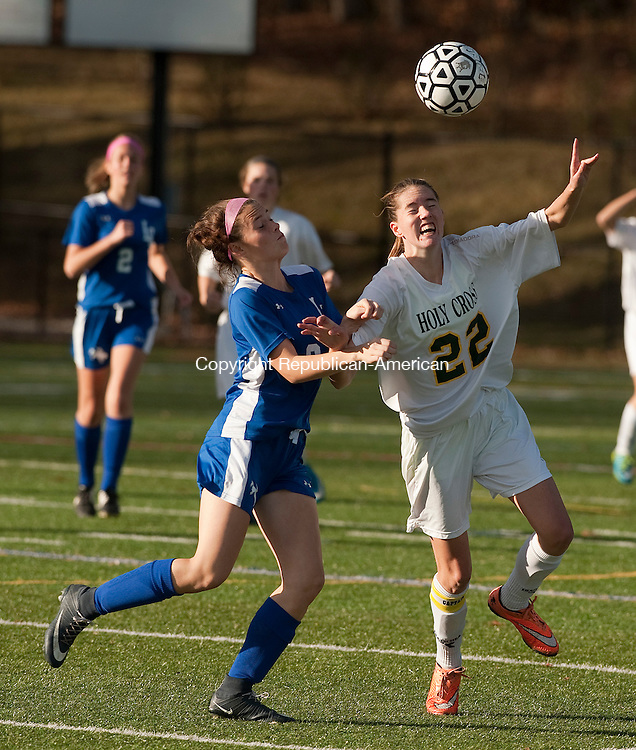 WATERBURY, CT--- -110915JS13--Litchfield's Kiley Harnish (9) and Holy Cross' Jordan Gilmore (22) battle for the ball during their first round game in the Class S girls soccer tournament Monday at Post University in Waterbury. <br /> Jim Shannon Republican-American