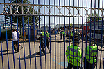 Visiting fans making their way past police officers on Cattall Road before entering St. Andrew's stadium, prior to Birmingham City's Barclay's Premier League match with Wolverhampton Wanderers. Both clubs were battling against relegation from  England's top division. The match ended in a 1-1 draw, watched by a crowd of 26,027.