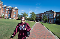 Drill Field sidewalk with student walking.<br />  (photo by Megan Bean / &copy; Mississippi State University)