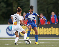 Boston Breakers forward Lianne Sanderson (10) dribbles as Western New York Flash defender Estelle Johnson (12) closes. In a National Women's Soccer League (NWSL) match, Boston Breakers (blue) tied Western New York Flash (white), 2-2, at Dilboy Stadium on August 3, 2013.