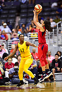 Washington, DC - June 15, 2018: Washington Mystics guard Kristi Toliver (20) shoots a three point basket over Los Angeles Sparks center Jantel Lavender (42) during game between the Washington Mystics and Los Angeles Sparks at the Capital One Arena in Washington, DC. (Photo by Phil Peters/Media Images International)